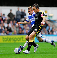 Photo: Leigh Quinnell.<br /> Queens Park Rangers v Cardiff City. Coca Cola Championship. 18/08/2007. Cardiffs Gavin Rae holds off QPRs Martin Rowlands.