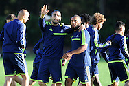 Swansea city player Chico Flores (l) with Ashley Williams ® wave to the camera's.  Swansea city FC training at their training base in Landore  in Swansea, South Wales on Wed 23rd Oct 2013. The team are training ahead of the UEFA Europa league match v FC Kuban Krasnodar . pic by Andrew Orchard, Andrew Orchard sports photography,
