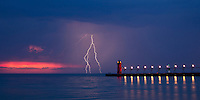 """After watching a partial solar eclipse set on Lake Michigan on May 20,2012,  This awesome lightning storm gave me several opportunities to catch lightning strikes over South Beach pier, in South Haven Michigan. This image is natively a 10x20"""" panoramic print and is recommended for metallic paper."""