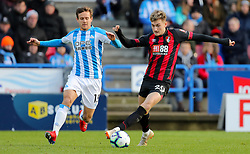 Huddersfield Town's Chris Lowe (left) and Bournemouth's David Brooks battle for the ball during the Premier League match at the John Smith's Stadium, Huddersfield.