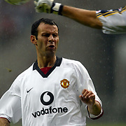 Manchester United's Ryan Giggs has the ball punched from the top of his head