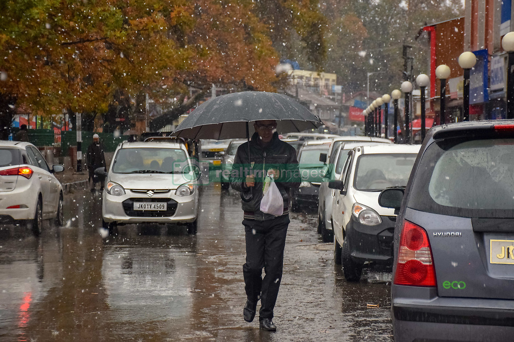 November 3, 2018 - Srinagar, Jammu & Kashmir, India - Kashmiri Muslim man with umbrella seen walking during the season's first snow fall..Snowfall in the Indian parts of Kashmir has disrupted power supply, air traffic, and road traffic between Srinagar and Jammu, the summer and winter capitals of India's Jammu-Kashmir state, according to news reports. (Credit Image: © Idrees Abbas/SOPA Images via ZUMA Wire)
