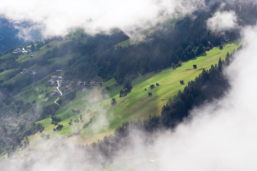 IFTE-NB-007650; Niall Benvie; View into the valley around Fliess from Kaunergrat visitor's centre; Austria; Europe; Tirol; horizontal; green; meadow forest woodland; 2008; July; summer; fog mist rain cloud; Wild Wonders of Europe Naturpark Kaunergrat