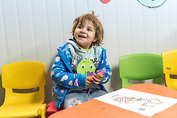 20 February 2020, Za'atari Camp, Jordan: Four-year-old Hajar Abas-Abas spends her day at the Smurf Centre, a daycare centre operated by the Lutheran World Federation in the Za'atari Camp for Syrian refugees. The centre is intended to help empower women in the camp by giving them space to attend life skills trainings or other activities. For Hajar, however, spending time at the Smurf Centre has had a profound impact, as she had been falling behind in development of her speaking abilities, something that has come to develop much more quickly after coming to the Smurf Centre.
