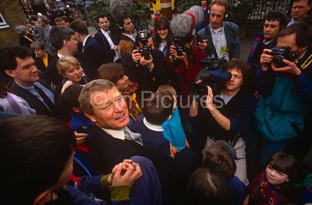 Surrounded by media is Liberal Democrat leader Paddy Ashdown while campaigning in Richmond, on 17th March 1992 in London, England. With a total of 22 seats won 22.6%  of the vote,  the Lib Dems came third in the 92 election after the re-election victory by John Majors Conservatives.
