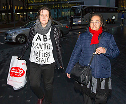 "© Licensed to London News Pictures. 29/01/2016. London, UK. JOSEPHINE HERIVEL (L) wearing a t-shirt with the words ""A B - FRAMED BY BRITISH STATE""  written on it, and CHANDRA BALAKRISHNA (R) leave Southwark Crown Court in London where Maoist cult leader Aravindan Balakrishnan has been sentenced to 23 years in prison for rape, child cruelty and false imprisonment. Aravindan Balakrishnan was found guilty of the rape of two of his followers and and false imprisonment of  his daughter for more than 30 years in a commune in south London.  Photo credit: Peter Macdiarmid/LNP"