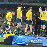 An injured Quade Cooper, Australia, on crutches, is helped onto the stage by Radike Samo during the Australia V Wales Bronze Final match at the IRB Rugby World Cup tournament, Auckland, New Zealand. 21st October 2011. Photo Tim Clayton...
