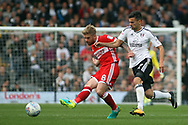 Adam Clayton of Middlesbrough (L) under pressure from Rui Fonte of Fulham (R). EFL Skybet championship match, Fulham v Middlesbrough at Craven Cottage in London on Saturday 23rd September 2017<br /> pic by Steffan Bowen, Andrew Orchard sports photography.