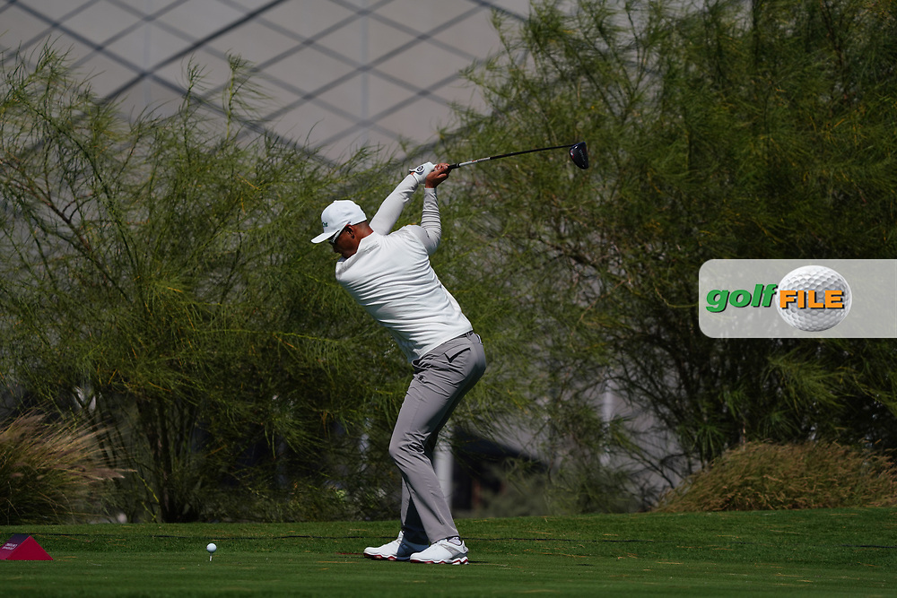 Haotong Li (CHN) on the 18th during the Pro-Am of the Commercial Bank Qatar Masters 2020 at the Education City Golf Club, Doha, Qatar . 04/03/2020<br /> Picture: Golffile | Thos Caffrey<br /> <br /> <br /> All photo usage must carry mandatory copyright credit (© Golffile | Thos Caffrey)