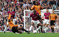 Fotball<br /> 2004/2005<br /> Foto: SBI/Digitalsport<br /> NORWAY ONLY<br /> <br /> West Ham v Wolverhampton Wanderers<br /> Coca-Cola Championship.  Upton Park.<br /> 02/10/2004<br /> <br /> Wolves' captain Paul Ince tackles West Ham's Nigel Reo-Coker