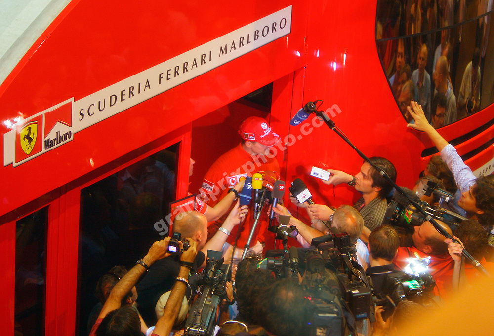 Late on Saturday night, Ferrari driver Michael Schumacher tell reporters about his crash during qualifying. Photo: Grand Prix Photo