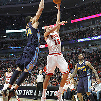 26 March 2012: Chicago Bulls center Joakim Noah (13) goes for the skyhook over Denver Nuggets center JaValee McGee (34) during the Denver Nuggets 108-91 victory over the Chicago Bulls at the United Center, Chicago, Illinois, USA. NOTE TO USER: User expressly acknowledges and agrees that, by downloading and or using this photograph, User is consenting to the terms and conditions of the Getty Images License Agreement. Mandatory Credit: 2012 NBAE (Photo by Chris Elise/NBAE via Getty Images)