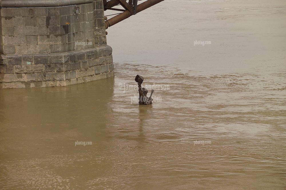 """""""Captains Return"""" Statue up to his neck with flood water. Saint Louis MO, 100 Year Flood on the Mississippi River 19 March 2008."""