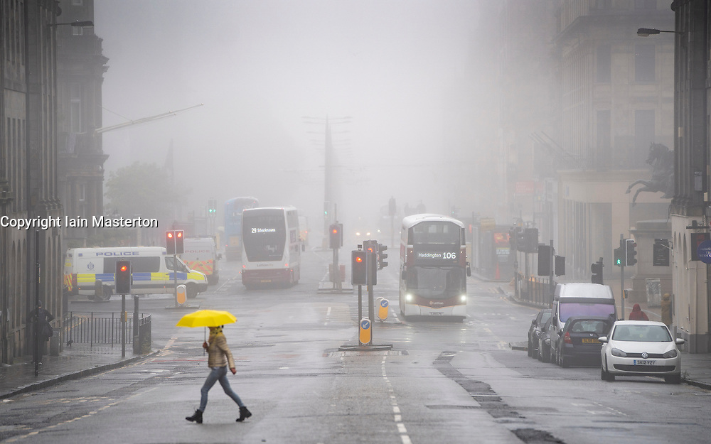 Edinburgh, Scotland, UK. 13 June 2020. A thick fog ,or haar as it is called locally, covers the city and obscures the city. This is the view along Princes Street. Iain Masterton/Alamy Live News