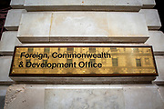The Foreign and Commonwealth Office brass plaque sign outside the office building on King Charles Street on the 8th of September 2020 in Westminster, London, United Kingdom. The Foreign Office launched a rebrand and merger as the Foreign, Commonwealth and Development Office on the 1st of September 2020, the current secretary of state is Dominic Raab MP.  (photo by Andy Aitchison)