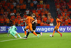 AMSTERDAM, NETHERLANDS - JUNE 17: Denzel Dumfries of Netherlands scores their side's second goal past Daniel Bachmann of Austria during the UEFA Euro 2020 Championship Group C match between the Netherlands and Austria at Johan Cruijff Arena on June 17, 2021 in Amsterdam, Netherlands. (Photo by Christopher Lee - UEFA)