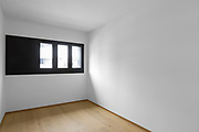 Empty room with three windows and parquet. Nobody inside