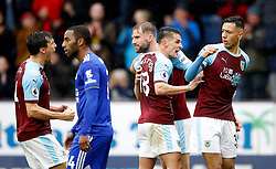 Burnley's Dwight McNeil (right) celebrates scoring his side's first goal of the game during the Premier League match at Turf Moor, Burnley.