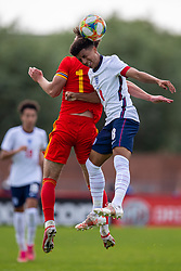 NEWPORT, WALES - Friday, September 3, 2021: England's captain Rico Lewis (R) challenges for a header with Wales' Cian Ashford during an International Friendly Challenge match between Wales Under-18's and England Under-18's at Spytty Park. (Pic by David Rawcliffe/Propaganda)