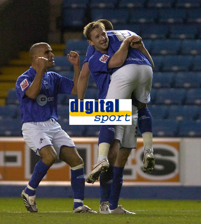 Photo: Matt Bright/Sportsbeat Images.<br /> Millwall v AFC Bournemouth. The FA Cup. 01/12/2007.<br />  Bryan Hodge lifts Will Hoskins watched by Marcus Bignot in celebration of millwall's second goal