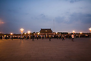 Tourists on Tiananmen Square to watch the daily flag raising ceremony at sunrise, a must-see event for mainland tourists visiting their national capital city.