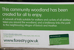 Sign about community woodland