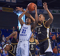 Middle Tennessee Blue Raiders guard Jordan Davis (11) shoots as Southern Miss Golden Eagles forward Boban Jacdonmi (13) defends during the Southern Mississippi Golden Eagles at Middle Tennessee Blue Raiders college basketball game in Murfreesboro, Tennessee, Saturday, March, 7, 2020.<br /> Photo: Harrison McClary/All Tenn Sports
