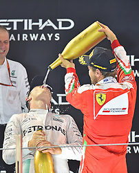 "Sebastian Vettel (GER#5), Scuderia Ferrari ""duscht"" Weltmeister 2016, 2. Platz im Rennen, Nico Rosberg (GER#6), Mercedes AMG Petronas Formula One Team mit Rosenwasser beim Rennen im Rahmen des Grand Prix von Abu Dhabi auf dem Yas Marina Circuit / 271116<br /> <br /> ***Abu Dhabi Formula One Grand Prix on November 27th, 2016 in Abu Dhabi, United Arab Emirates - Race Day ***"