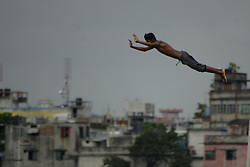 July 18, 2017 - Dhaka, Bangladesh - Bangladeshi boys jump on Buriganga river to cool themselves during a hot day on July 19, 2017 in Dhaka, Bangladesh. (Credit Image: © Syed Mahamudur Rahman/NurPhoto via ZUMA Press)