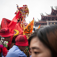 """Mazu is carried through Meizhou's main square where 10,000 people have gathered to celebrate her birthday. <br /> <br /> The Chinese Communist Party (CCP) still struggles with how to deal with the resurgence of folk religion.  The CCP adheres to a traditional point of view that folk religion is not """"institutional religion"""" like Buddhism, Taoism, Confucianism, Christianity, and Islam. Instead, the government views folk religion as a set of traditional beliefs and practices. Because of this, believers who want to revive religious customs and local government officials who wish to increase tourism to an area may use the political strategy of classifying folk religious practice as cultural heritage.  In 2009 UNESCO designated Mazu worship as """"intangible cultural heritage of humanity."""""""