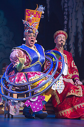 """© Licensed to London News Pictures. 05/12/2013. London, England. Picture: Matthew Kelly as Widow Twankey and John Conroy as Emperor. The Panto Aladdin starring Jo Brand as the Genie of the Ring and Matthew Kelly as Widow Twankey opens at the New Wimbledon Theatre, Wimbledon, London. From 6 December 2013 to 10 January 2014. Further actors: the dance group """"Flawless"""" as the Peking Police Force, Oliver Thornton as Aladdin, David Bedella as Abanazar, Claire-Marie Hall as Princess Jasmine. Photo credit: Bettina Strenske/LNP"""