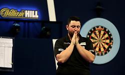 Luke Humphries celebrates winning his match during day twelve of the William Hill World Darts Championships at Alexandra Palace, London.