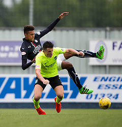 Falkirk's Nathan Austin and Hibernian's John McGinn. Falkirk 1 v 2 Hibernian, the first Scottish Championship game of season 2016/17, played 6/8/2016 at The Falkirk Stadium.