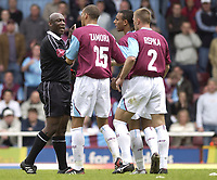 Photo: Daniel Hambury, Digitalsport<br /> West Ham United v Ipswich Town. <br /> The Coca Cola Championship. Play Off Semi Final First Leg.<br /> 14/05/2005<br /> West Ham's Bobby Zamora, Anton Ferdinand and Tomas Repka surround referee Uriah Rennie as the official awards the free kick that Ipswich score from.