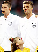 A player escort looks up at Thomas Müller #13 of Germany during the 2018 FIFA World Cup Russia group F match between Germany and Sweden at Fisht Stadium on June 23, 2018 in Sochi, Russia.