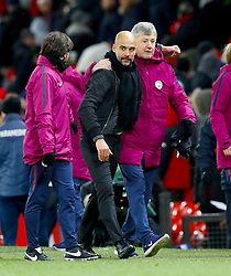 Manchester City manager Pep Guardiola and coaching staff celebrate after the final whistle of the Premier League match at Old Trafford, Manchester.