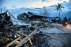 October 2, 2018 - Palu, Central Sulawesi, Indonesia - Indonesian people walking between the ruins of the house that is destroyed in Palu, after magnitude 7.5 earthquake and tsunami hit the area on September 28. The Indonesian government said the death toll on the island of Sulawesi had risen to 1,234 people. The quake caused thousands of homes to collapse, along with hospitals, hotels and shopping centers. Emergency services fear that the death toll could rise into the thousands as rescue teams made contact with the nearby cities of Donggala and Mamuju and strong aftershocks continue to rock the city. (Credit Image: © Ivan Damanik/ZUMA Wire) (Credit Image: © Ivan Damanik/ZUMA Wire)