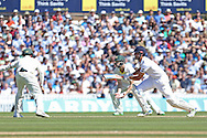 Captain Alastair Cook of England hits runs during the 3rd day of the Investec Ashes Test match between England and Australia at the Oval, London, United Kingdom on 22 August 2015. Photo by Phil Duncan.