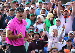 April 8, 2018 - Augusta, GA, USA - Patrick Reed makes a par putt on the 18th green to win the Masters at 15-under par at Augusta National Golf Club on Sunday, April 8, 2018, in Augusta, Ga. (Credit Image: © Curtis Compton/TNS via ZUMA Wire)