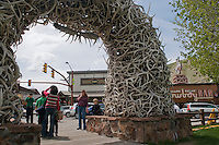 Tourists snap photos near the famous antler arch on the southwest corner of the Jackson Town Square in Jackson, Wyo.