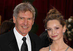 Harrison Ford and Calista Flockhart arrive for the 80th Academy Awards (Oscars) at the Kodak Theatre, Los Angeles.