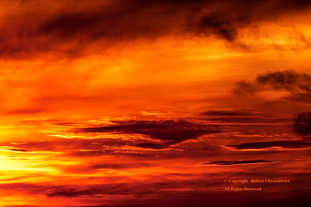 Phenom Penh Red: A dramatic red morning sky triumphs over the coming day above Phnom Penh Cambodia.