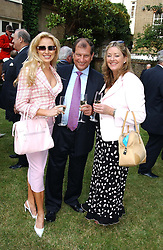 Left to right, MISS LOUISE LAKIN, BOB CHAMPION and LORRAINE HARRIS-YOUNG at a garden party at the Goring Hotel, Beeston Palce, London SW1 to celebrate the unveiling of a bronze bust the late Queen Elizabeth the Queen Mother on 20th July 2004.