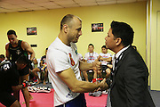 """Igor Svirid, One middleweight world champion from Kazakstan in Red locker room with CEO of ONE Victor Cui<br /><br />MMA. Mixed Martial Arts """"Tigers of Asia"""" cage fighting competition. Top professional male and female fighters from across Asia, Russia, Australia, Malaysia, Japan and the Philippines come together to fight. This tournament takes place in front of a ten thousand strong crowd of supporters in Pelaing Stadium. Kuala Lumpur, Malaysia. October 2015"""