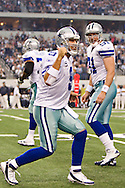 ARLINGTON,  TX - NOVEMBER 6:   Tony Romo #9 of the Dallas Cowboys celebrates after a touchdown against the Seattle Seahawks at Cowboys Stadium on November 6, 2011 in Arlington, Texas.  The Cowboys defeated the Seahawks 23 to 13.  (Photo by Wesley Hitt/Getty Images) *** Local Caption *** Tony Romo Sports photography by Wesley Hitt photography with images from the NFL, NCAA and Arkansas Razorbacks.  Hitt photography in based in Fayetteville, Arkansas where he shoots Commercial Photography, Editorial Photography, Advertising Photography, Stock Photography and People Photography