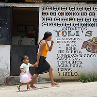 Livingston, Guatemala 21 May 2008<br /> A woman walks with a girl in a street of Livingstone.<br /> Photo: Ezequiel Scagnetti