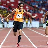 Ismi Zakiah (#34) of Singapore Sports School wins the A Division girls' 100m final. (Photo © Lim Yong Teck/Red Sports)