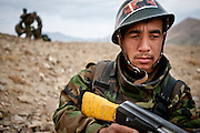 An Afghan National Army soldier keeps watch moments after an engagement with Afghan insurgents.