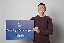 "CARDIFF, WALES - Monday, November 7, 2016: Wales' James Chester holds up a board ""Dewch yn Bencampwr"" to encourage people to become volunteers for the 2017 UEFA Champions League Final in Cardiff. (Pic by David Rawcliffe/Propaganda)"
