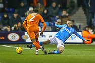 Bradford City defender Paul Caddis (38) slides in to tackle Luton Town defender James Justin (2) during the EFL Sky Bet League 1 match between Luton Town and Bradford City at Kenilworth Road, Luton, England on 27 November 2018.